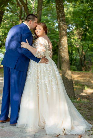 Anomalie specialized in making online wedding dresses for plus sized brides, including dresses with champagne fabric, long sleeves, and floral lace.