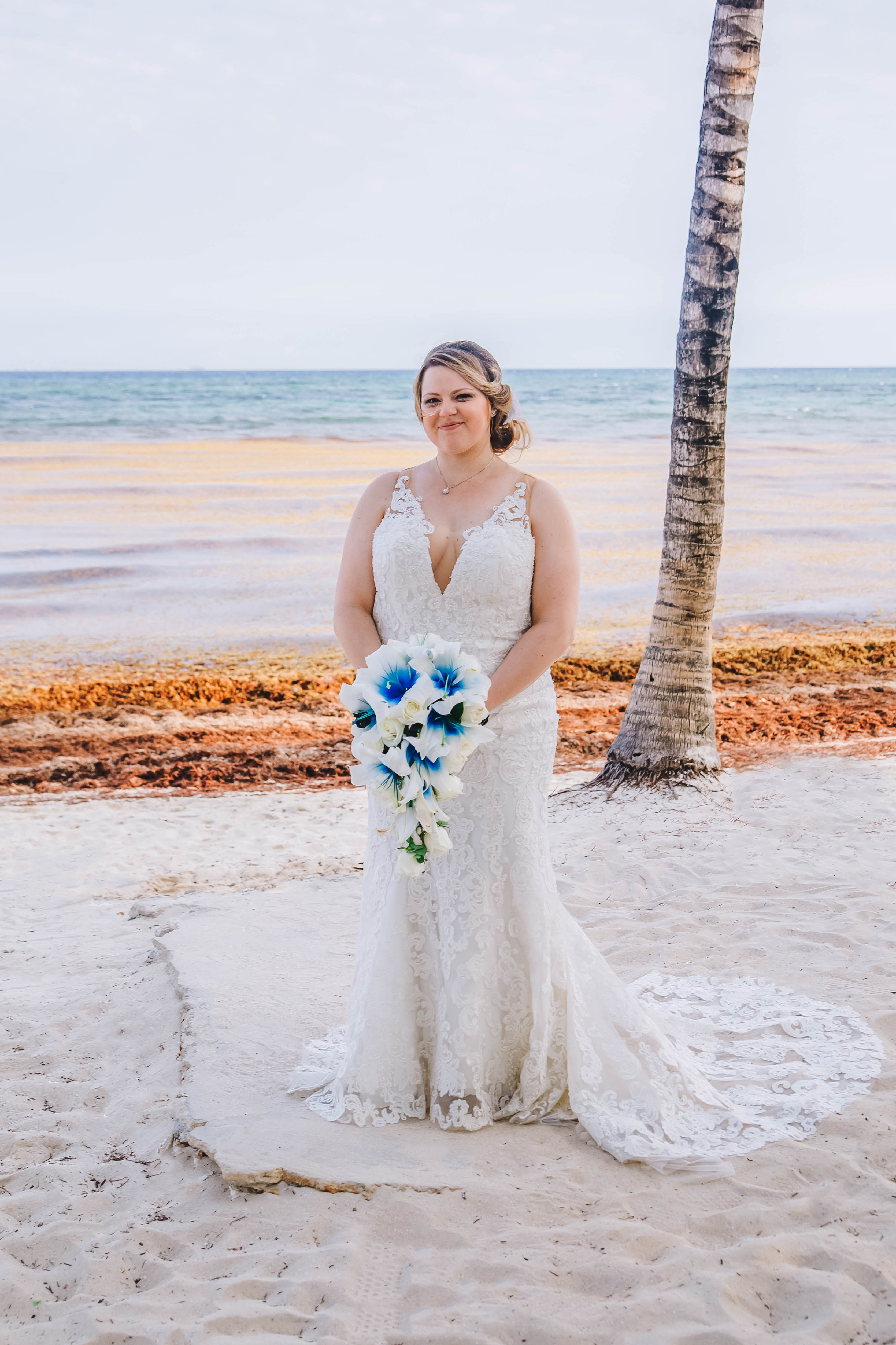 Anomalie specialized in making online wedding dresses for plus sized brides, including dresses with plunging necklines, and allover lace.