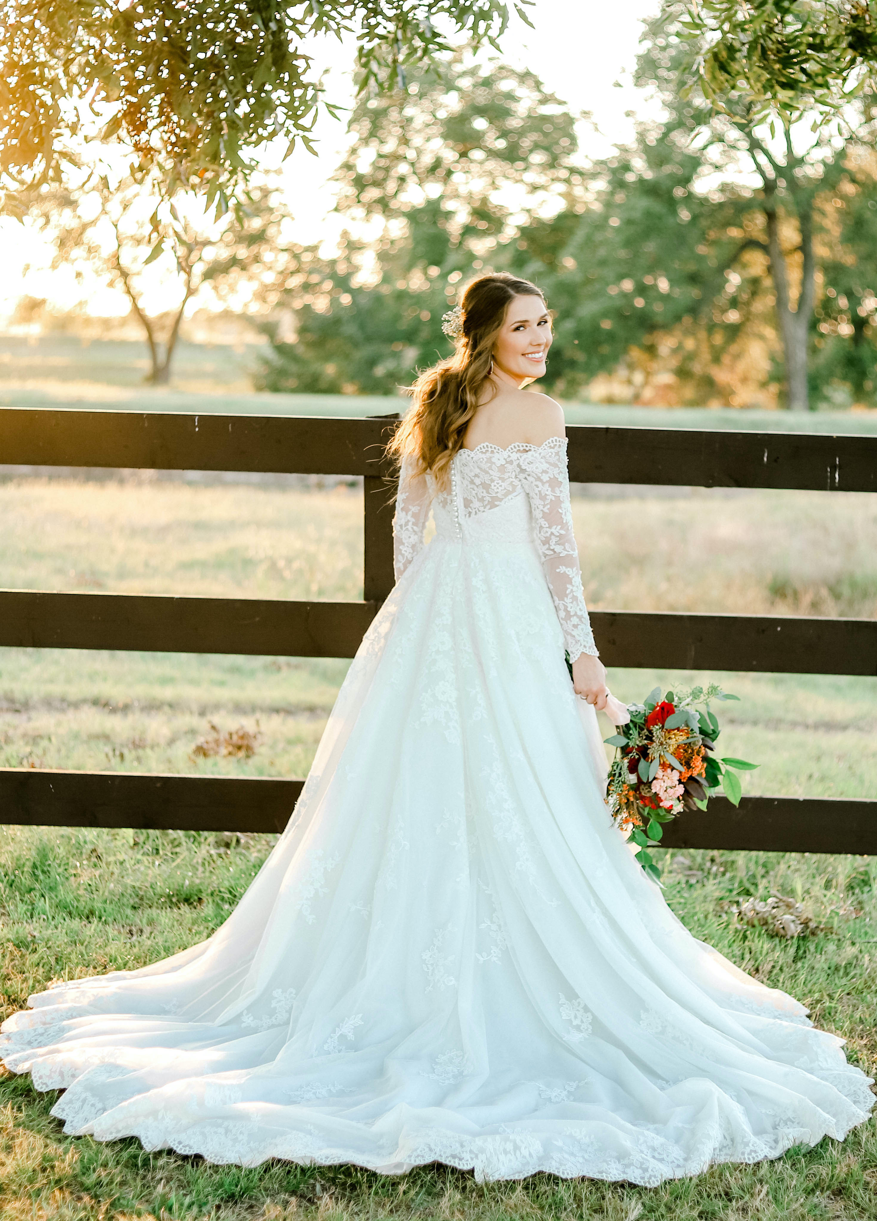 This bride designed an A-line wedding dress with lace long sleeves online with Anomalie.