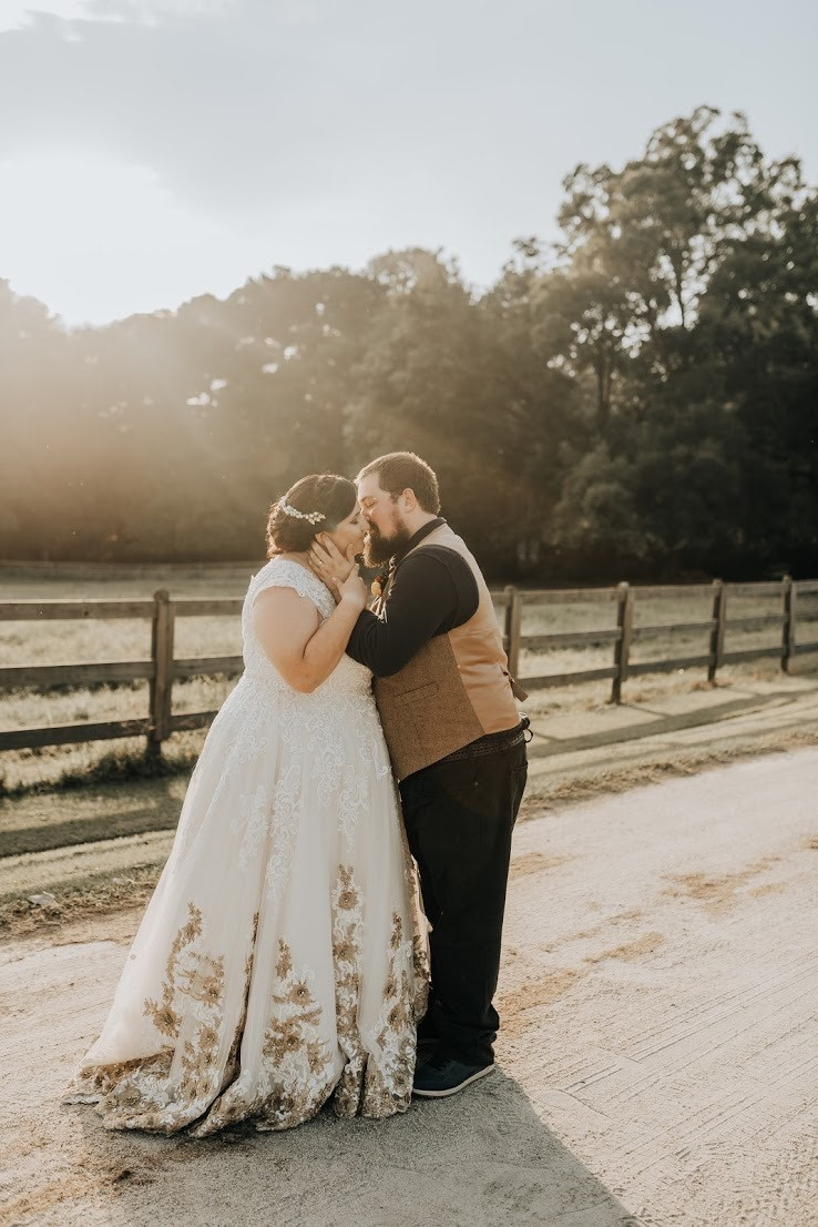 Anomalie specialized in making online wedding dresses for plus sized brides, including dresses with a-line silhouette and gold lace.