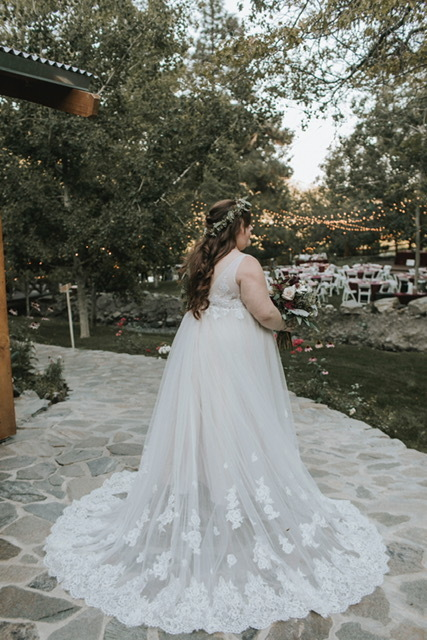 Anomalie specialized in making online wedding dresses for plus sized brides, including dresses with relaxed a-line silhouette and empire waist bodice.