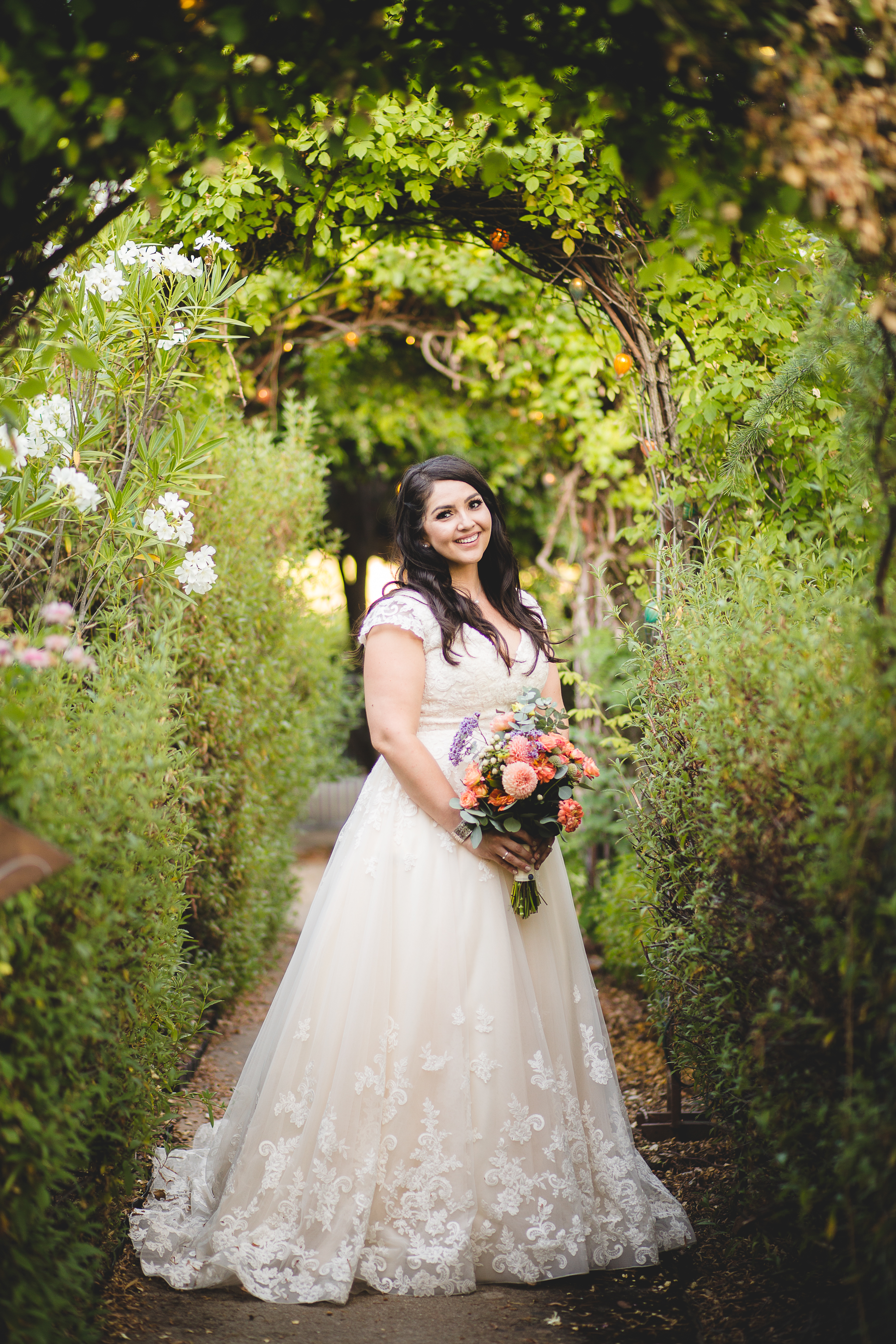 Anomalie specialized in making online wedding dresses for plus sized brides, including dresses with cap sleeves and cascading floral skirt.