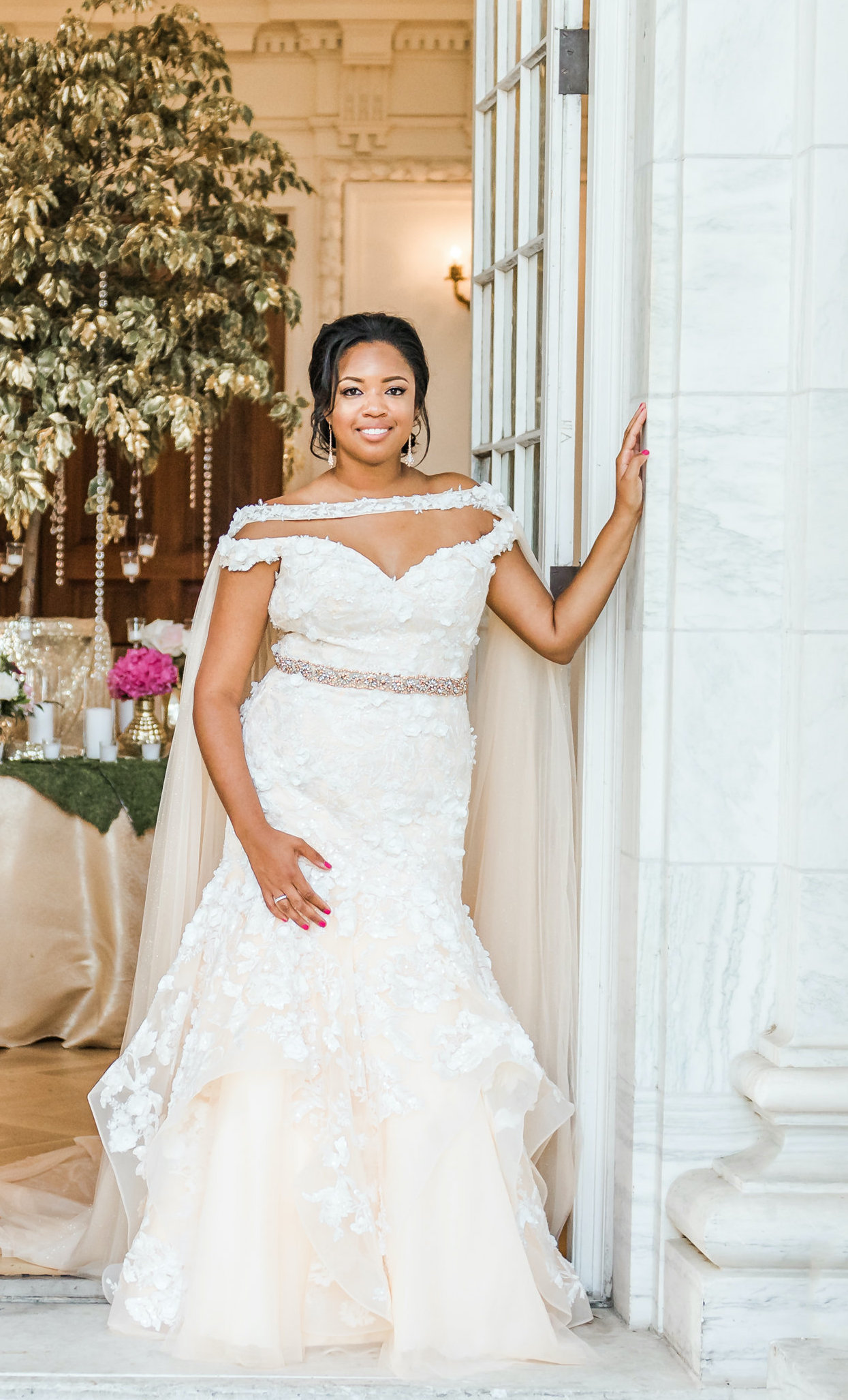Anomalie specialized in making online wedding dresses for plus sized brides, including dresses with off the shoulder sleeves, floral lace, and tiers.