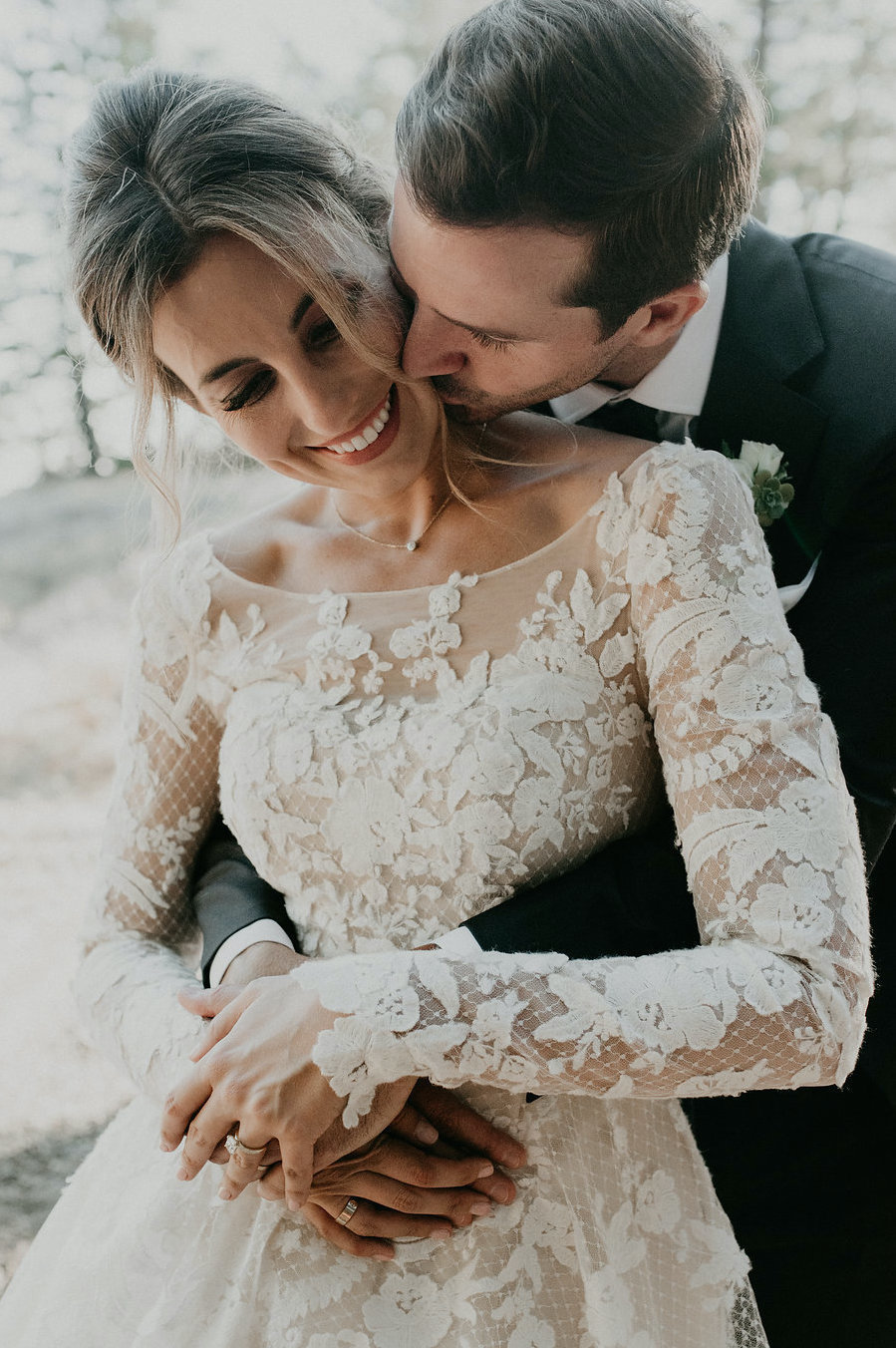 Bride customized her wedding dress with Anomalie Online Wedding Dresses with long sleeves, floral lace applique, and swiss dot fabric.