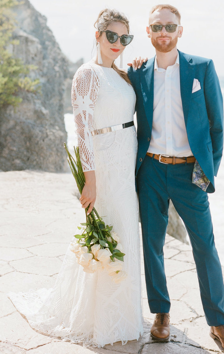 This bride designer her long sleeve wedding dress online with geometric sheet lace.