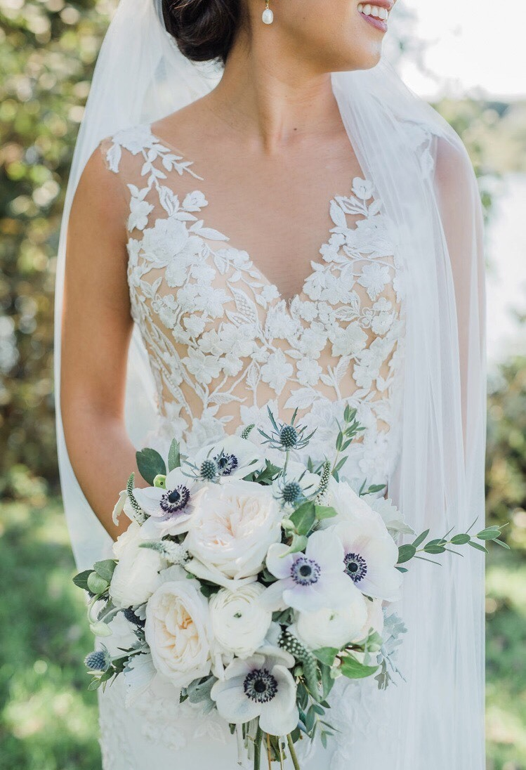 Bride customized her wedding dress with Anomalie Online Wedding Dresses with nude lining and delicate floral lace.