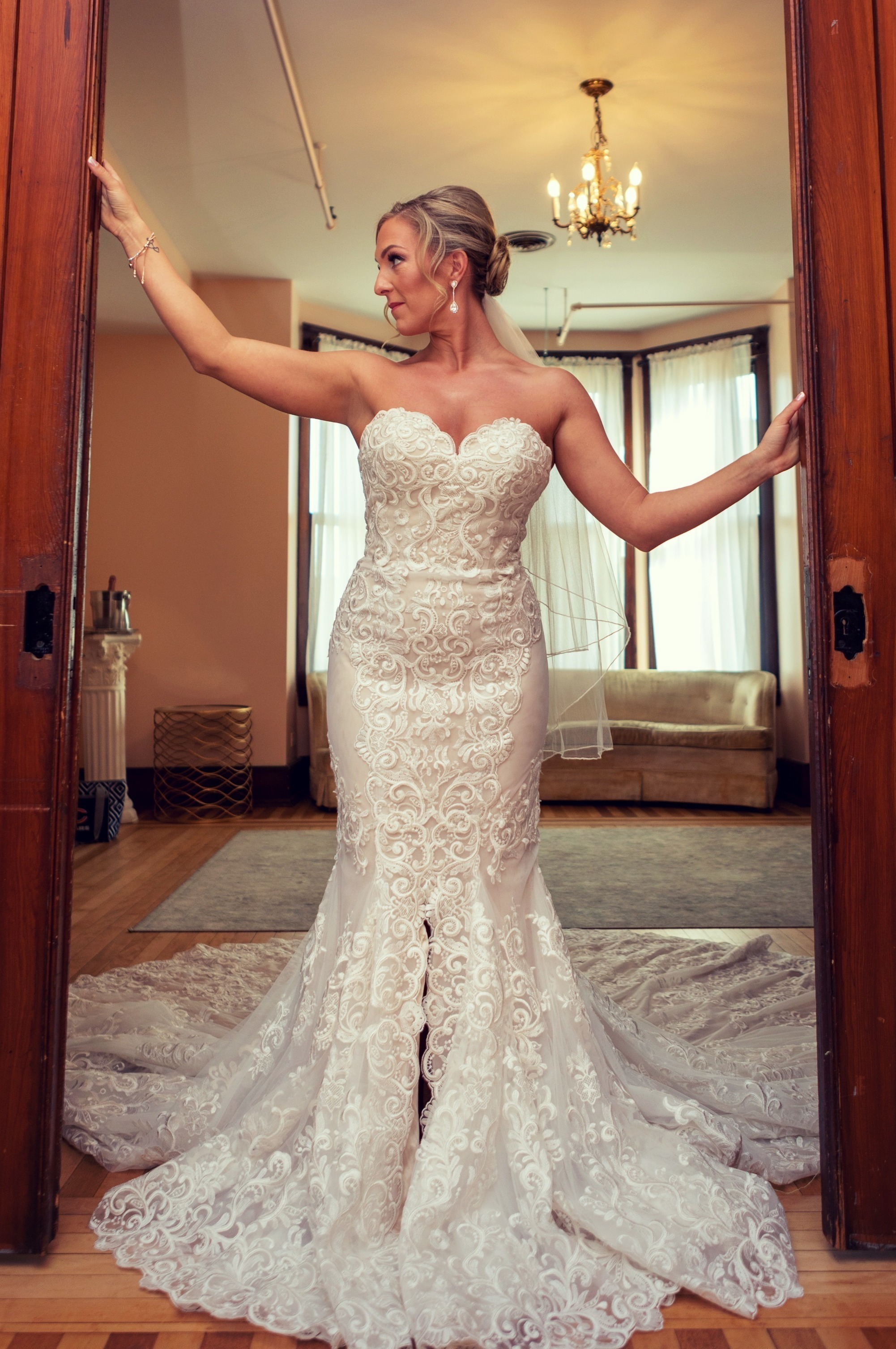 Bride customized her wedding dress with Anomalie Online Wedding Dresses with sweetheart neckline, center slit, and dramatic train.