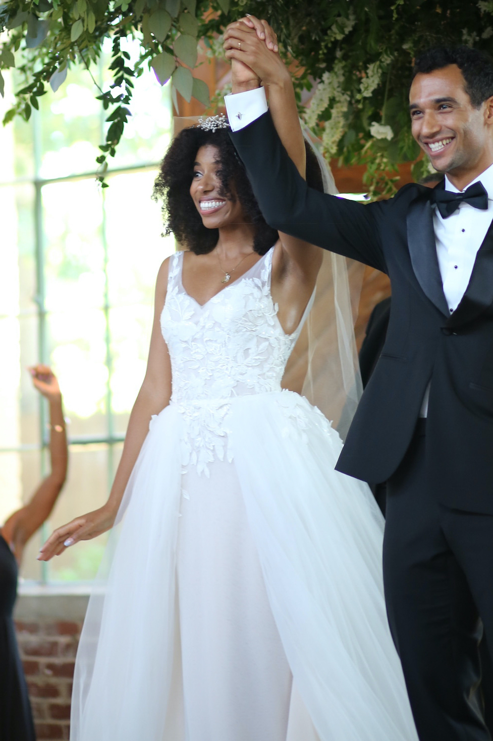 Bride customized her wedding dress with Anomalie Online Wedding Dresses with v-neck, lace, and overskirt.