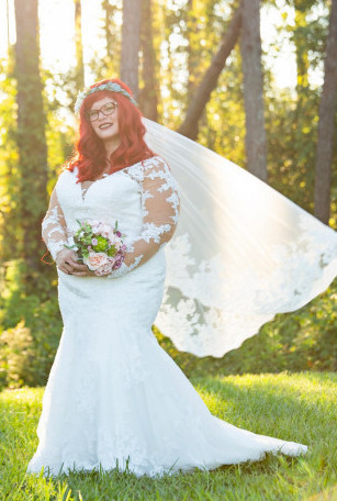 Anomalie specialized in making online wedding dresses for plus sized brides, including dresses with long sleeves and mermaid silhouette.