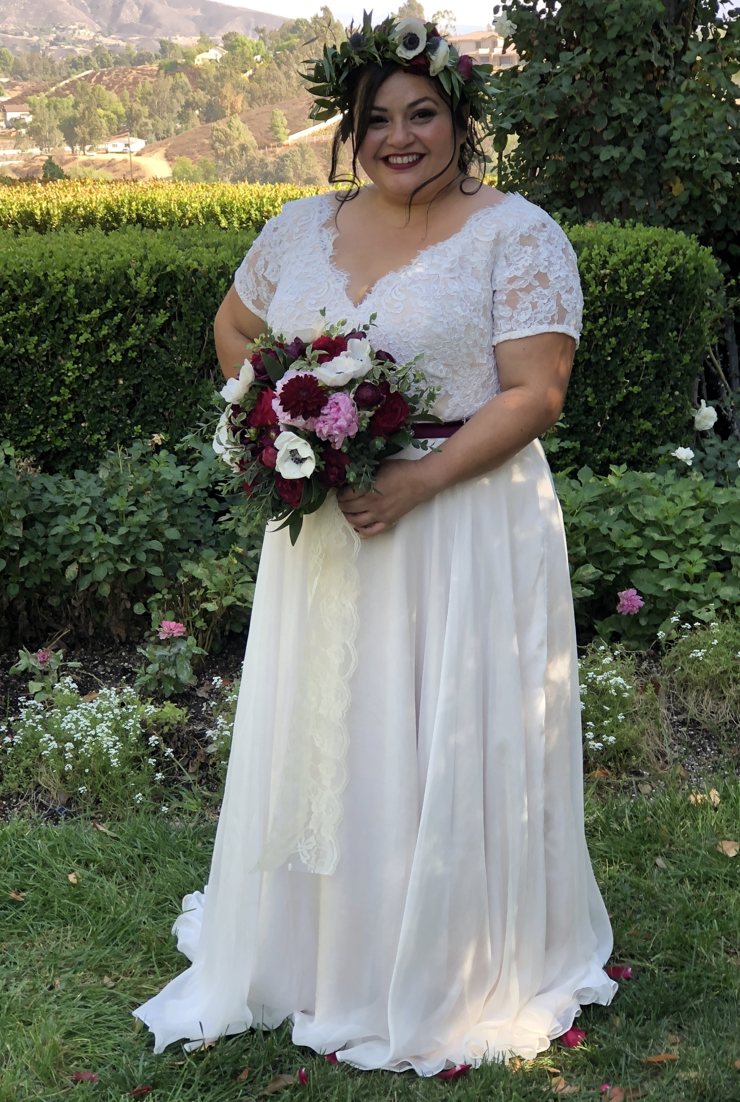 Anomalie specialized in making online wedding dresses for plus sized brides, including dresses with delicate sheet lace and short sleeves.