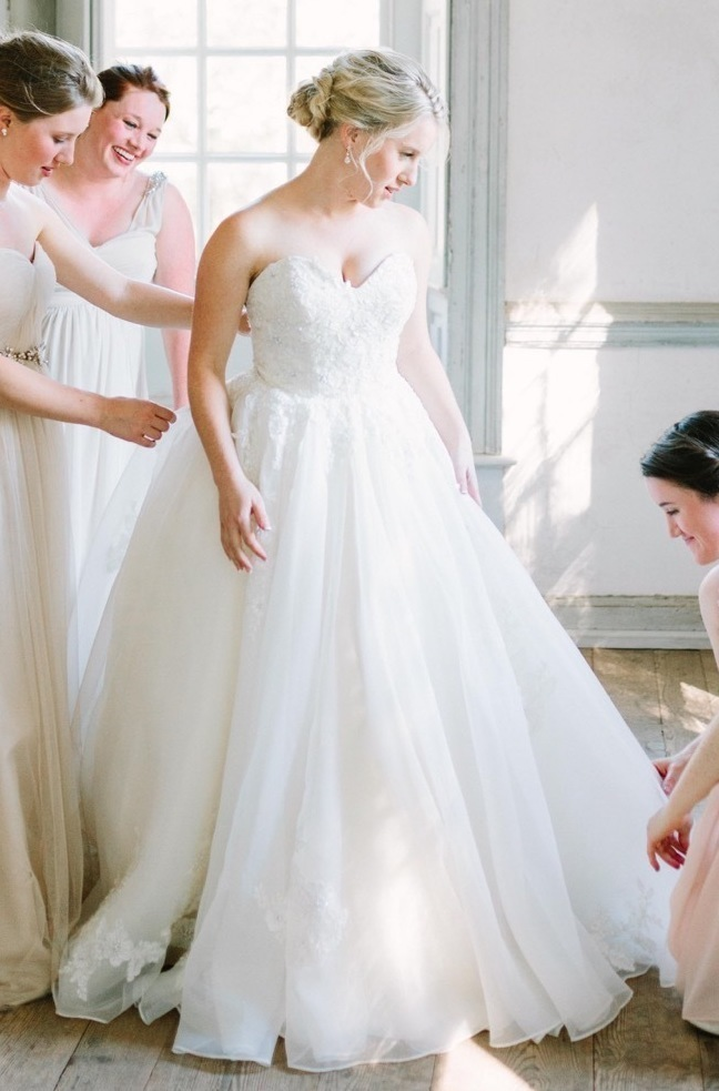 Bride customized her wedding dress with Anomalie Online Wedding Dresses with a sweetheart bodice and floral lace.