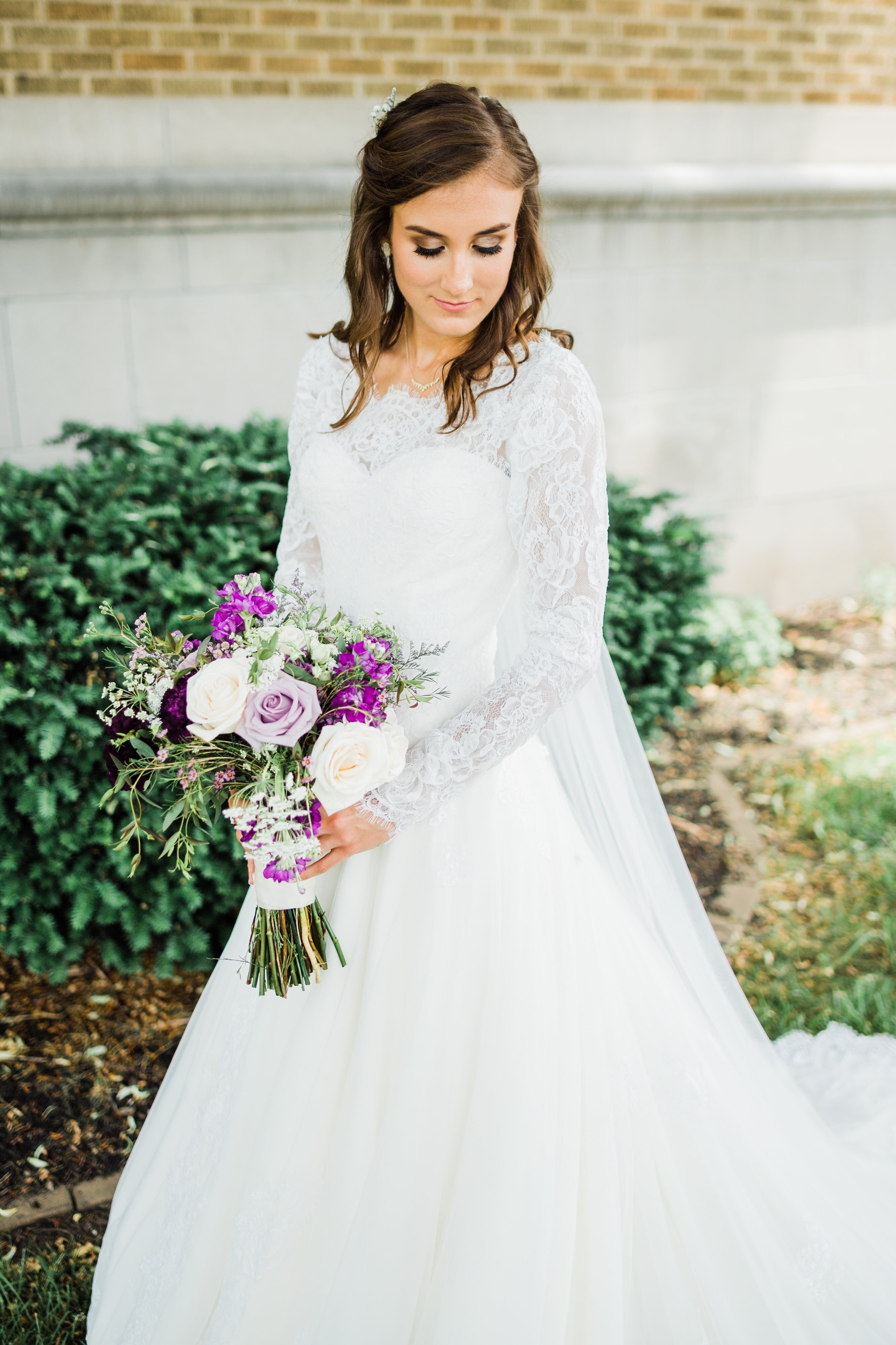 This bride designed a stunning long sleeve lace wedding dress online with Anomalie.