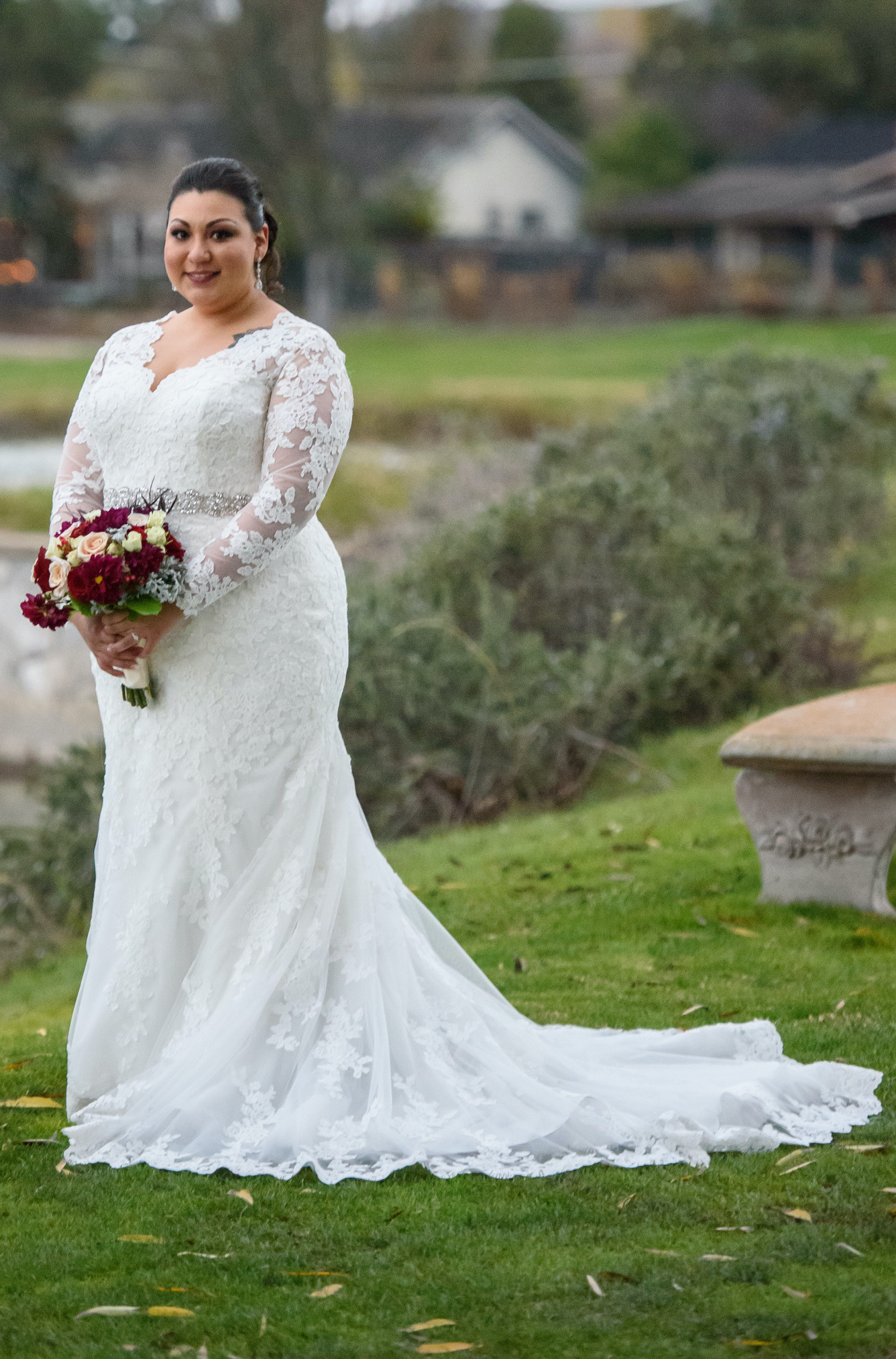 This bride designed a long sleeve lace wedding dress online with Anomalie, the leading online wedding dress company.