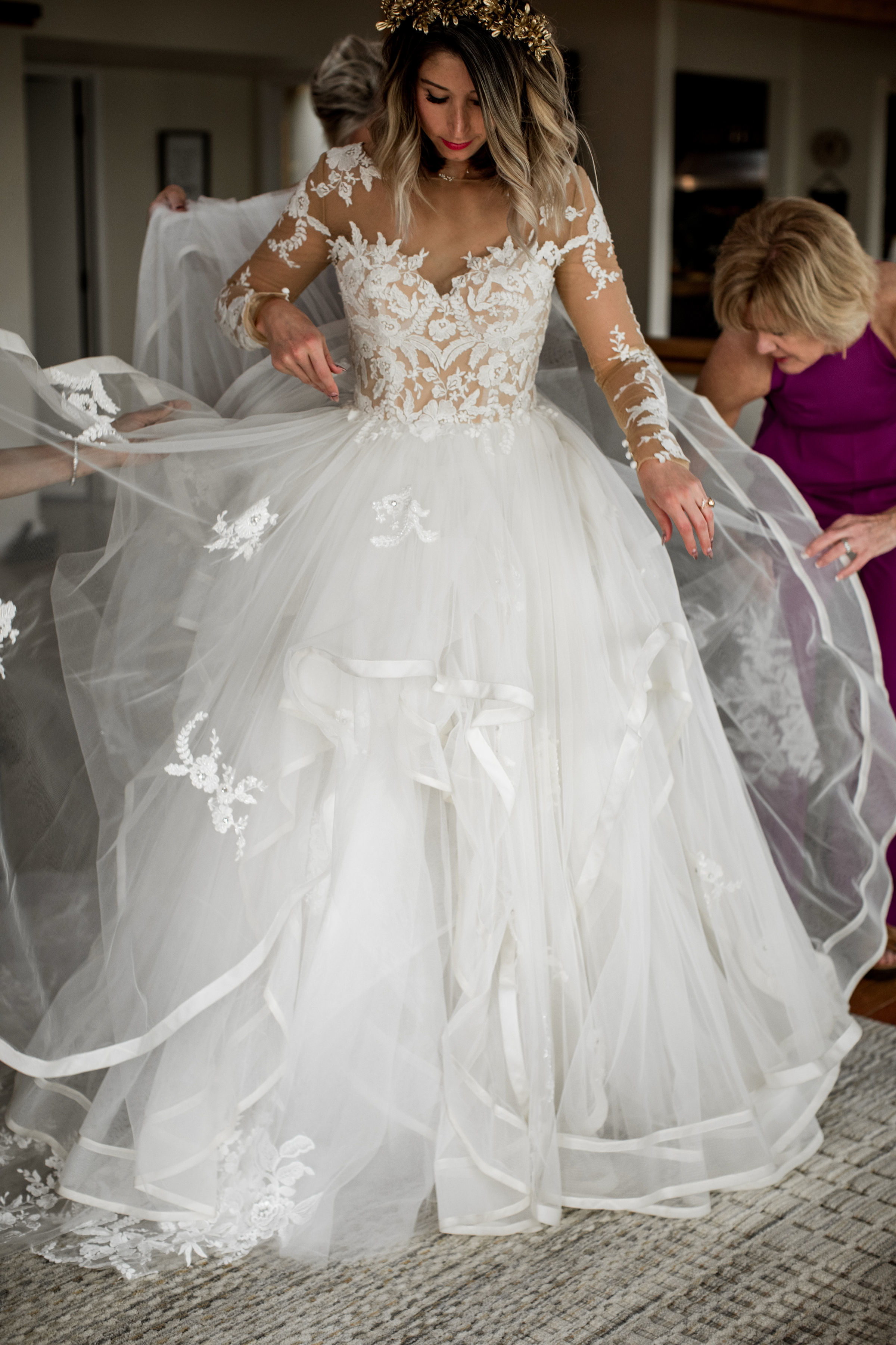 Bride customized her wedding dress with Anomalie Online Wedding Dresses with long sleeves, illusion mesh, floral lace, and voluminous tiers.