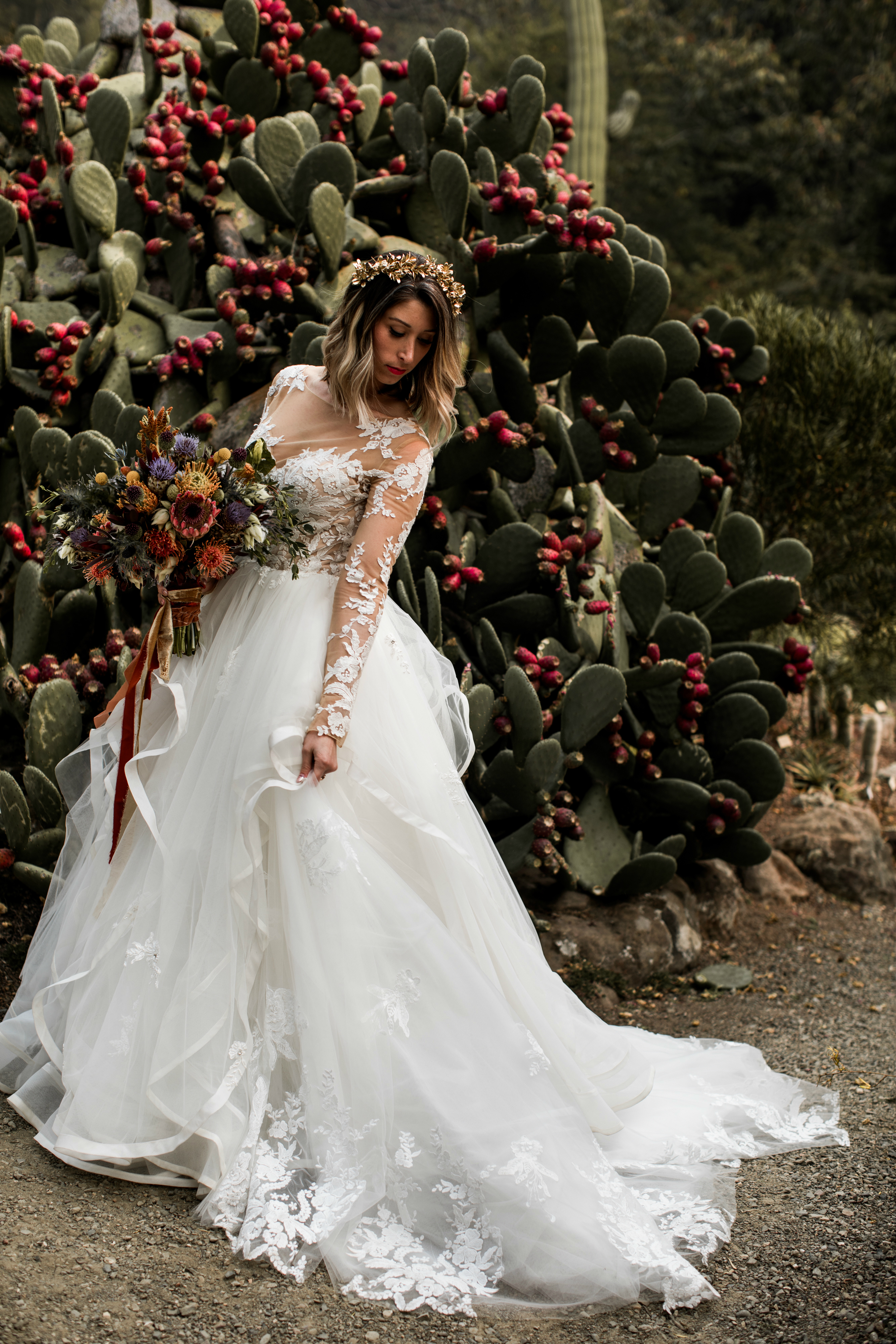 Brides order online wedding dresses from Anomalie with tiered skirts and floral lace.