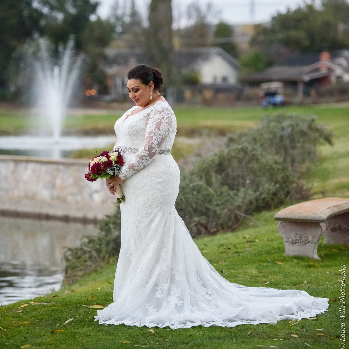 Anomalie long sleeve fit and flare custom wedding dress on plus size bride with scalloped hem, floral lace, and beaded belt