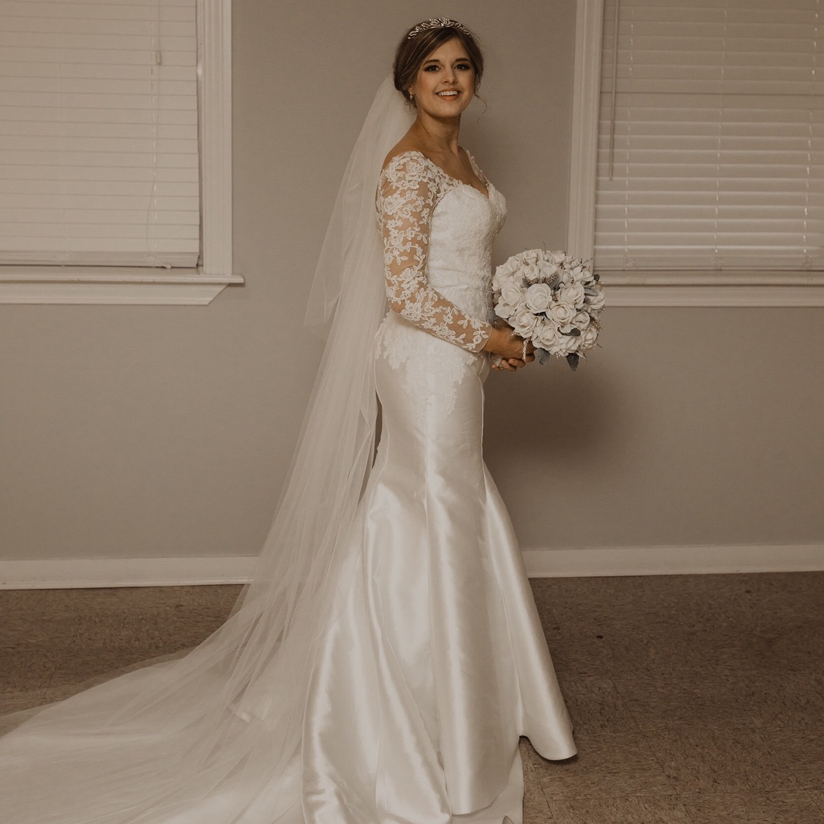 Anomalie custom soft white, fit-flare silhouette wedding dress with long sleeves, lace detailing, and deep v back, Louisiana wedding