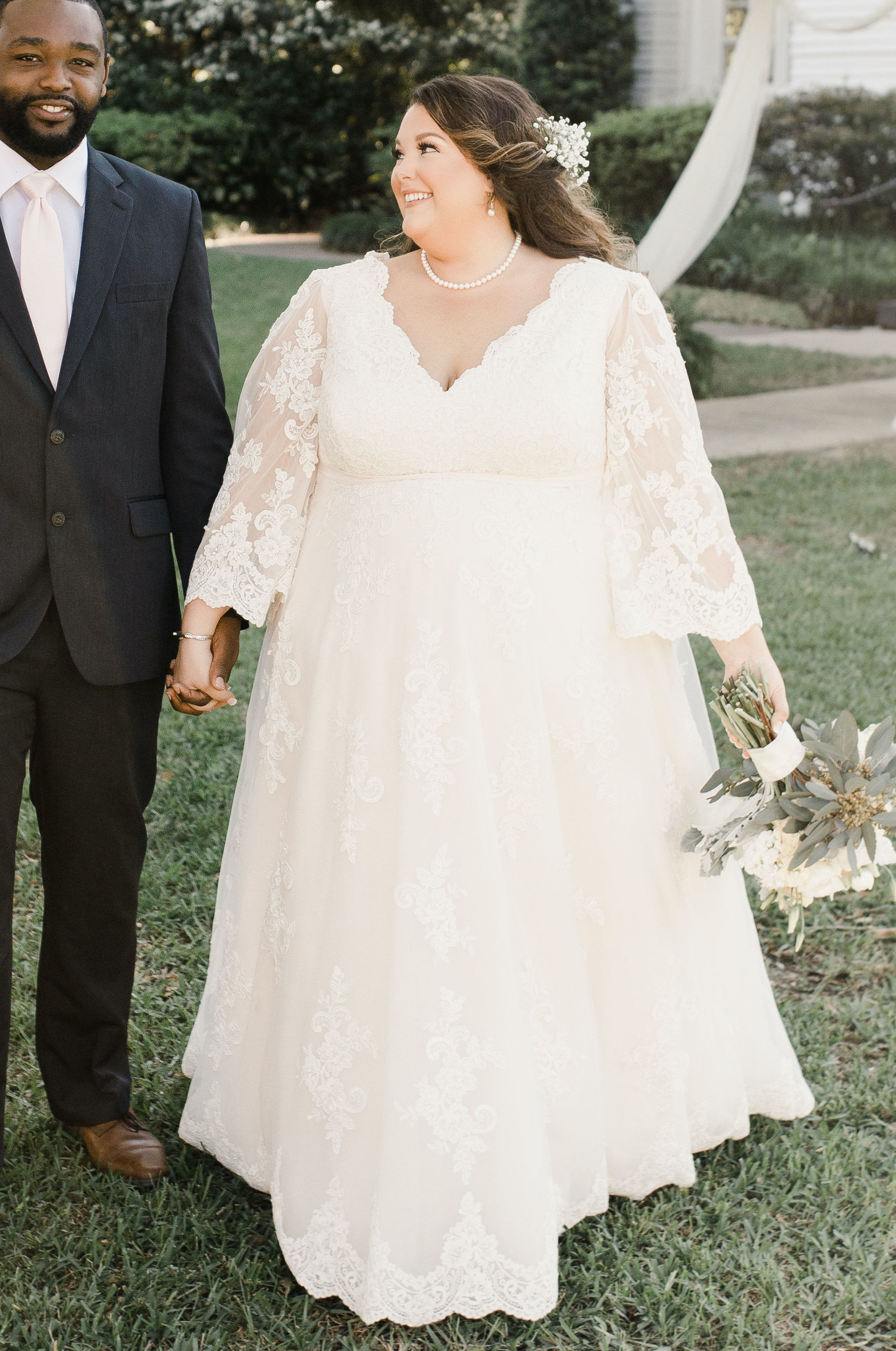 Anomalie is the best place for plus-size brides to create a wedding dress online. This brides online wedding dress has bell sleeves.
