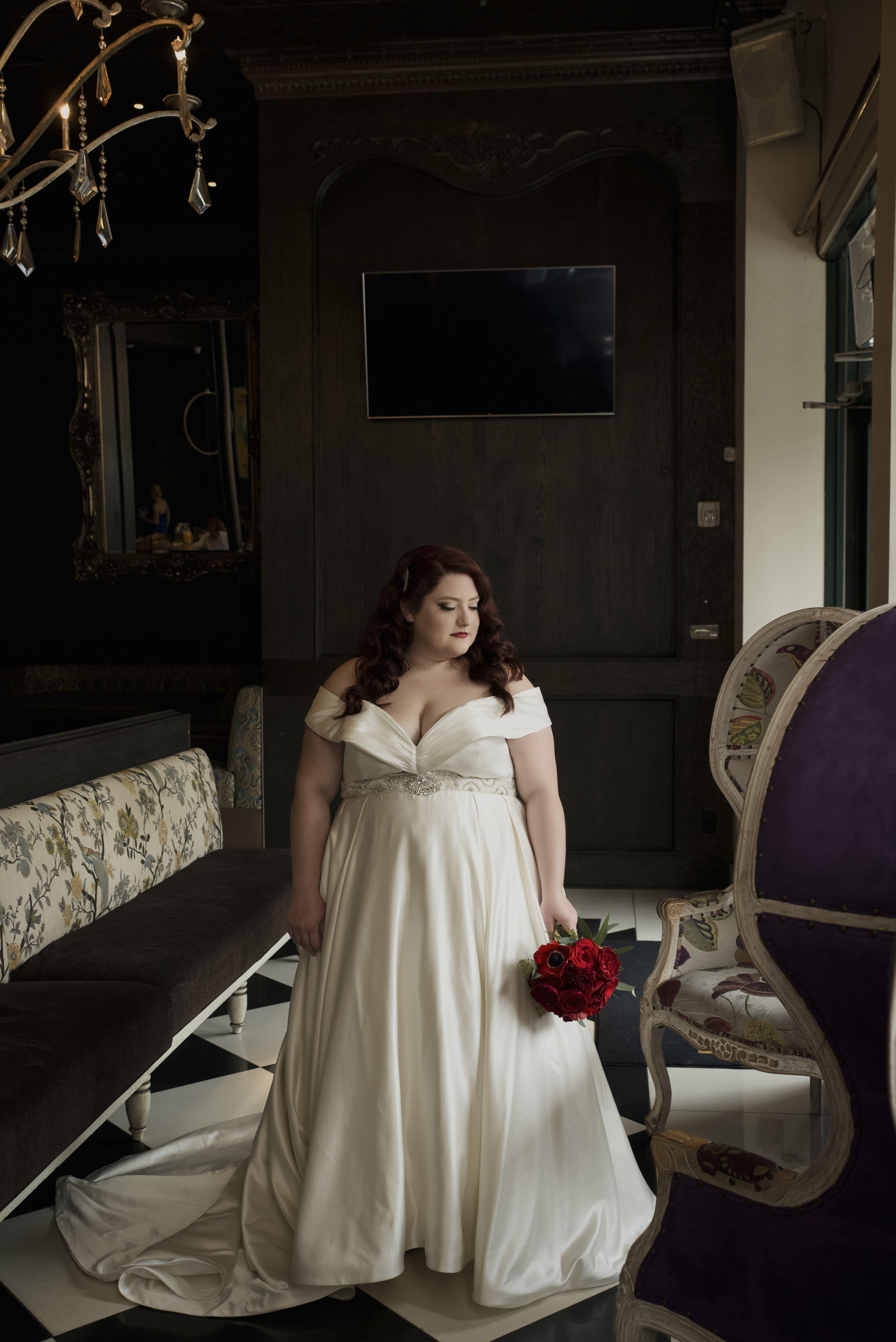 Anomalie specialized in making online wedding dresses for plus sized brides, including dresses with structured silhouette and off-the-shoulder sleeves.