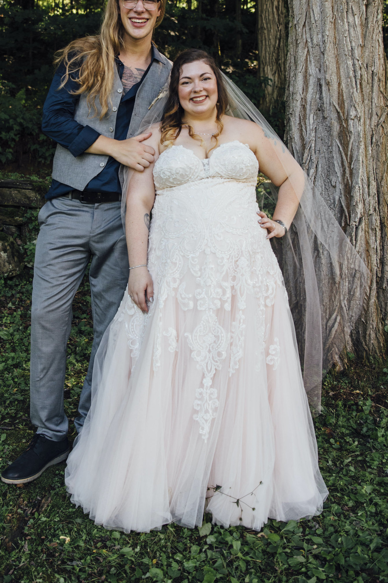 Anomalie specialized in making online wedding dresses for plus sized brides, including dresses with blush lining and floral lace & tulle.